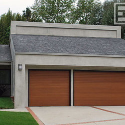 Modern Garage Doors | A Minimalistic Yet Contemporary Design for Garage Doors - Modern Garage Doors are popping up everywhere in 2012.  The architectural trend is changing to the swift and contemporary.  Our custom garage door designs are changing with the demand in modern architectural styles.  These modern garage doors are crafted in fine-lined, minimalistic style that fits this contemporary home to perfection.  Modern architecture calls for simplicity in fine design which is easy on the eye and quite elegant when paired with the right design elements.  Dynamic Garage Doors are discerningly designed to suit each home's architectural essence while maintaining a subtle appearance yet making huge curve appeal improvements. When you feel trapped with the ordinary modern garage doors styles simply call Dynamic Garage Door, we have the experience and experienced design team to make your garage door project extraordinary!