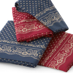 Traditions by Pamela Kline - Traditions Linens Bandana 280 Thread Count Egyptian Cotton Sheet Set - 382013700 - Shop for Sheets from Hayneedle.com! Warm and inviting the Traditions Linens Bandana 280 Thread Count Egyptian Cotton Sheet Set is perfect for fans of country-cottage style. Available in twin full queen and king sizes this super-soft and cozy 280-thread count sheet set is made from comfortable 100% Egyptian cotton fabric. Machine washable for easy maintenance it features a classic bandana design in your choice of navy or red. This set includes a fitted sheet flat sheet and coordinating pillowcases. The twin set comes with one standard pillowcase. Full and queen sets include two standard pillowcases and the king set features two king pillowcases.About Traditions LinensBased in Claverack N.Y. Traditions Linens is a family business that has been a leader in the world of home textiles bed linen design and manufacturing for more than 35 years. Drawing inspiration from her background in antiques the beauty of the Hudson Valley and her frequent travels Pamela Kline creates fine bedding collections that layer texture color and pattern in all-natural fibers and with meticulous attention to detail. The company's product line includes blankets sheet sets quilts towels window treatments duvet covers decorative pillows and more. Their products can be found in specialty boutiques home furnishing stores catalogs and online retailers in the United States Canada Europe South America and Asia.