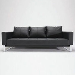 Cassius Deluxe Sofa Bed - Tufted leather is a supreme luxury. I especially love how the back of this convertible sofa is tufted. Overall, its design is such that I almost wouldn't believe that this is a sleeper sofa. I would love to be the house guest of the person that owns one of these modern pieces.