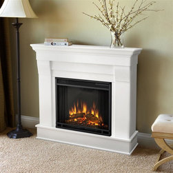 Real Flame - Chateau Electric Fireplace in White - 1400 Watt heater, rated over 4700 BTUs per hour . Programmable thermostat with display in Fahrenheit or Celsius . Ultra Bright LED technology with 5 brightness settings . Digital readout display with up to 9 hours timed shut off . Dynamic ember effect . Fireplace includes wooden mantel, firebox, screen, and remote control. Solid wood and veneered MDF construction. 40.9 in. W x 11.8 in. D x 37.6 in. H (78.6 lbs.)The Chateau Fireplace features the clean lines and classic styling familiar to stone mantels, realized in wood. In three great finishes, this design is sure to compliment a variety of decor, from the classic to contemporary. The Vivid Flame Electric Firebox plugs into any standard outlet for convenient set up. Thermostat, timer function, brightness settings and ultra bright Vivid Flame LED technology.