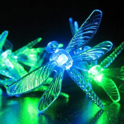 Smart Solar Dragonfly Solar Light String - 20 Color Changing LED Dragonflies - Give your plants, pathways, and patio a warm, inviting glow with the Smart Solar Dragonfly Solar Light String - 20 Color Changing LED Dragonflies. This solar-powered decorative light string features 20 energy-saving, multicolored LEDs with translucent covers shaped like dragonflies. It automatically lights up at dusk to enhance your outdoor settings. These solar lights provide up to six hours of illumination when the replaceable, rechargeable Ni-MH battery (included) has been fully charged by the sun. The LED string can be placed even in shady spots because the separate solar panel can be positioned elsewhere in the sun.About Smart SolarDriven by a strong belief in the environmental benefits of solar power, and the realization that consumers are becoming increasingly environmentally aware with an interest in buying solar-powered products, Smart Solar was created in 2003. Based near Oxford in the U.K., Smart Solar has offices in the U.S. and Germany, and a manufacturing facility in Thailand. Smart Solar offers products including solar pumps, water features, lights, ventilators, chargers, and specialty garden items. With such a wide range of solar-powered products, Smart Solar uses an equally wide range of materials to make them, including terra cotta, ceramic, copper, slate, glass, aluminum, resin, and stainless steel. With an eye for fulfilling future consumer needs, and a heart for preserving the environment, Smart Solar is devoted to developing innovative, high-quality, and dependable solar-powered products.