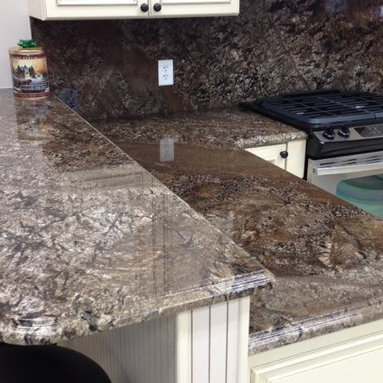 Kitchens - Feratto is extracted from Levantina's quarry in Brazil. Beautiful granite that is full of movement. Feratto granite, granite island, kitchen island, Levantina, brown granite