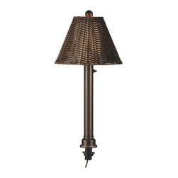 "Patio Living Concepts - Patio Living Concepts Umbrella Table Lamps 12777 Table Lamp w/ 2 Inch Bronze Tub - 12777 Table Lamp w/ 2 Inch Bronze Tube Body & Walnut All-Weather Wicker Shade belongs to Umbrella Table Lamps Collection by Patio Living Concepts Add fashionable styling and light to your outdoor dining table. Features all resin construction and fits 1 7/16"" diameter or larger umbrella table hole. Accomodates table thicknesses up to 3"". Unbreakable polycarbonate waterproof light bulb enclosure allows the use of a standard 60 watt bulb. Complete with on/off dimmer switch and 20 ft. weatherproof cord and plug. Lamp (1)"