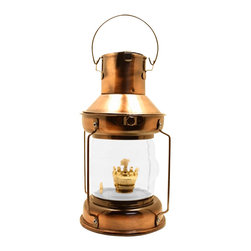 "9.5"" Copper Plated Anchor Oil Lantern - The copper plated anchor oil lantern is available in size 9.5""H. It is made of copper plating  is available in oil only. It will add a definite nautical touch to wherever it is placed and is a must have for those who appreciate high quality nautical decor. It makes a great gift, impressive decoration and will be admired by all those who love the sea."