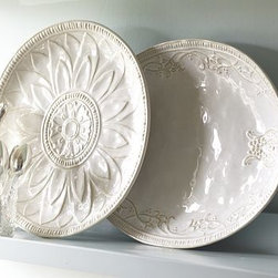 """Juliette Oversized Ceramic Round Serving Platter - Embossed floral motifs and scrollwork elevate the simple, generous designs of our Juliette platters. X-Large Round: 18"""" diameter, 2"""" high X-Large Rectangular: 13.5"""" wide x 8.5"""" deep x 2"""" high X-Large Oval: 21"""" wide x 16"""" deep x 2"""" high Made of stoneware with embossed patterns and an ivory reactive-glaze finish."""