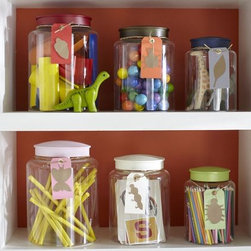 Acrylic Jars - These cute storage containers come with painted metal lids. I like that they are acrylic, so there is no risk of your little one breaking them. They're a great way to store stuff, and they look good too!