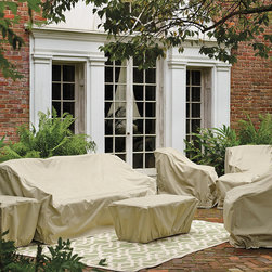 Frontgate - Hampton Outdoor Sofa Cover - Covers fit our most popular outdoor furniture pieces. Made of heavy-duty, 600 denier polyester. Lined with a layer of waterproof PVC. Soft fleece underside protects aluminum frames. 500 hour UV tested. We've re-engineered our best-selling premium furniture covers to provide an unparalleled level of protection for your outdoor furnishings. Designed with meticulous detail, these durable three-ply covers boast 600-denier polyester outer shell and a layer of waterproof PVC to ensure superior performance and long-lasting functionality in searing sun, blinding rain, prodigious snow, and bitter cold.  .  .   Won't fade in the hottest sun, or crack in temperatures dropping to 0 degreesF. Double-stitched seams (6 stitches per inch). Elastic edging, drawstrings, or reinforced ties hold covers securely in place. Built-in mesh vents with protective flaps help circulate air and keep water and mildew from reaching inside. Deep seating and chaise covers include an embroidered Frontgate logo . Easy to care for. Imported.
