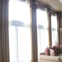 two story drapery over pinch pleat sheers -