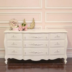 Stunning Curvy White Rose 9 Drawer Dresser - This gorgeous dresser features 9 drawers. Long drawers in the middle with narrower ones on the ends.. Each drawer has been adorned with lovely appliques and glass knobs. Perfect for any shabby cottage chic bedroom!