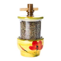 Herbes de Provence Refillable Grinder - Handcrafted and handpainted grinders, made in a small town on the Cote d'Azur, Vallauris, well-known for its pottery artisans. Even the great Picasso went there to learn about pottery (1948-1955). Add the flavor of Provence to your kitchen with this blend of Herbes de Provence - a delicious mix of basil, thyme, marjoram, savory, & rosemary. You can use Herbes de Provence on poultry, fish, meats. Another idea is to add a pinch to your coals while grilling for a wonderful aroma and flavor. Use for either a fine or coarse grind.