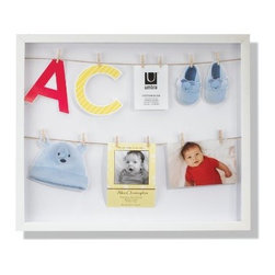 Umbra - Umbra Clothesline Shadowbox Picture Frame - The inspiration for Clothesline came from the designer's trip to Venice, Italy, where he saw something special in the narrow streets with clotheslines draped from house to house. This simple function caught his eye and inspired a frame with the same casual feel when displaying photos and keepsakes. The white molded frame contains two twine lines strung from end to end, each bearing six miniature clothespins for hanging pictures, birth announcements, invitations, postcards and other momentos.
