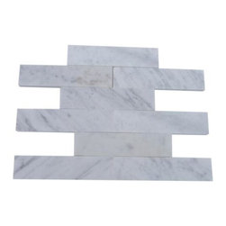 Brushed Stone White Carrera 2x8 Marble Tile - This white Carrara marble from Italy provides both classic and contemporary appeal. The neutral color of this natural stone allows you to create a space that's elegant, yet blends easily into the surrounding design scheme. Use it to create a shower wall or as a kitchen backsplash.