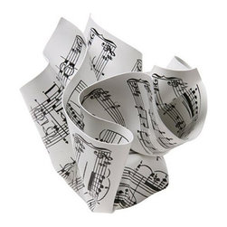 MoMa - Crumpled Paperweight - Sheet Music - The Sheet Music Paperweight is a bit of 3-D wit for the desktop, and a practical way to hold down papers. The clever style of designer Tibor Kalman is evident in this rigid silk-screened vinyl paperweight, hand-crumpled and wrapped around a steel weight. This paperweight is ideal for musician, aspiring and professional alike.