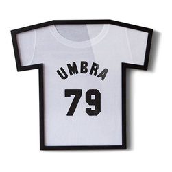 Umbra - T-Frame T-Shirt Frame, Black - The T-Frame T-Shirt Frame is the most fun and innovative way to display your prized t-shirts and jerseys! Simply wrap the shirt around the inner form, smooth out any wrinkles, insert into the frame, and hang! Perfect for band and concert tees, autographed sports jerseys, and commemorative shirts of all kinds. The T-Frame measures 21.5 by 19.5 inches and is constructed of durable molded material with a plexi lens. The T-Frame T-Shirt Frame works best with small, medium or large shirts.