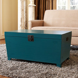 Turquoise Pyramid Trunk Coffee Table - This eye-catching trunk offers scads of storage and makes a great coffee table or bedroom bench. It comes in several colors, but how can you resist this gorgeous teal/turquoise hue?