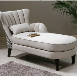 Uttermost Zea Chaise Lounge - Beige - Bring a touch of drama to your living room or bedroom with the Uttermost Zea Chaise Lounge - Beige. The clean look of soft linen fabric creates a timeless elegance, while the zebra-patterned back adds a touch of fun. The channel-back tailoring and welt details give it the feeling of a Hollywood Regency piece. Ebony legs create a striking contrast for a piece that melds modern and classic looks seamlessly.About UttermostThe mission of The Uttermost Company is simple: to make great home accessories at a reasonable price. This has been their objective since founding their family-owned business over 30 years ago. Uttermost manufactures mirrors, art, metal wall art, lamps, accessories, clocks, and lighting fixtures in its Rocky Mount, Virginia factories. They provide quality furnishings throughout North and South America, Europe, and Asia from their state-of-the-art distribution center located on the West Coast of the United States.