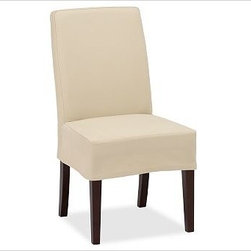 Napa Side Chair Slipcover, Short-Length Brushed Canvas Raffia - Offering the utmost in comfort and versatility, our Napa Chair has a deeply cushioned seat that's covered with oat cotton-twill fabric and stands on espresso-stained legs. Machine-washable slipcovers are available for an easy style update. Sturdily crafted with a hardwood frame, legs and backrest. Each slipcover is tailored specifically for our Napa Chair, so the look is tailored and the fit is perfect every time. Chairs and slipcovers are sold separately; choose from a variety of options below. Monogramming is available at an additional charge. Monogram will be centered on the backrest section of the slipcover. Select items are Catalog / Internet Only. View our {{link path='pages/popups/fb-dining.html' class='popup' width='480' height='300'}}Furniture Brochure{{/link}}.
