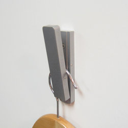 Hook by Artisan Machinery - The self-closing Hook addresses the need for clever storage solutions in efficient, modern spaces.  It is the perfect solution for hanging items behind a door, in a narrow hallway, or on a yacht. When not in use, Hook closes itself by the force of gravity alone and looks more like an artistic design accent, rather than a coat hook.  In short, Hook gives you clever, elegant design with practical performance.