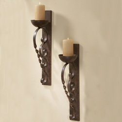 Twisted Pillar Wall Sconces (Set of 2) - From any angle this pair of iron wall sconces finished in an antique gold will provide luxe lighting. Straight, solid wall mounts with twisted and rolled candle holders. Sold as a pair.