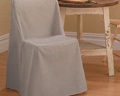 Sure Fit - Sure Fit Cotton Duck Folding Chair Cover - 13961 - Shop for Chair and Slip Covers from Hayneedle.com! The Straight Skirt with Ties cover is a one-piece furniture cover with patented seat elastic four sets of ties and inner pleats to minimize tucking. It features one set of ties on each corner to ensure a secure and attractive fit.About Sure FitSurefit Inc. is widely known for its attractive quality furniture covers slipcovers and decorative accessories. The success of their ready-made furniture slipcovers and accessories is based on extensive experience providing cost-effective decorative solutions made to fit in a broad range of styles to meet the needs of all customers. Sure Fit's furniture slipcover product line includes slipcovers for sofas loveseats chairs oversized chairs wing chairs dining room chairs recliners ottomans and folding chairs as well as furniture and pet throws. Sure Fit also sells coordinating decorative pillows. Sure Fit is dedicated to quality product with rigorous durability and performance standards that are second to none. Many patterns feature dual-action Scotchgard Protector to repel and release stains. Home of the Ten Minute Makeover Sure Fit provides an attractive and affordable solution for consumers who need to protect furniture from children pets and general wear or want to quickly and cost-effectively upgrade their furniture and enhance the appearance of any room.Please note this product does not ship to Pennsylvania.