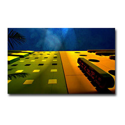 """South Beach Parking #2 - Canvas, 48x36x3 - Art is everywhere. Even a parking garage.  This piece is from a collection I've created of South Beach images.  In addition to the great architectural details I layered on a few """"spotlights"""" that expose the blue sky is a spray of light and contrast. As I often do—I pushed the color, especially saturating  the blues and yellows."""