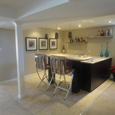 Contemporary Basement by Basements For Less