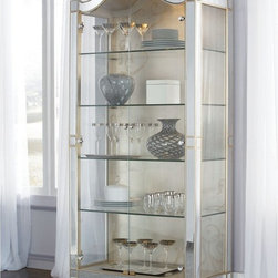 American Drew - American Drew Jessica McClintock Couture Curio Cabinet Multicolor - 908-855 - Shop for China from Hayneedle.com! Bring home the American Drew Jessica McClintock Couture Curio Cabinet and brighten your dining room. This curio cabinet features two doors with four adjustable glass shelves. The lighted interior of this cabinet adds sparkle to the artifacts glasses and crockeries placed inside. This product is a reflection of traditional design combined with today's functionality. The crown and legs of this cabinet have beautiful foliate patterns over them in a golden tone.About American DrewFounded in 1927 American Drew is a well-established leading manufacturer of medium- to upper-medium-priced bedroom dining room and occasional furniture. American Drew's product collections cover a broad variety of style categories including traditional transitional and contemporary. Their collections range from the legendary 18th-century traditional Cherry Grove celebrating its 42nd year of success to the extremely popular Bob Mackie Home Collection influenced by the world-renowned fashion designer Bob Mackie. Jessica McClintock Home features another beloved designer bringing unique style to an American Drew line. American Drew's headquarters are located in Greensboro N.C. Their products are distributed through thousands of independently owned retailers throughout the United States and Canada and around the world.