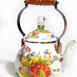 Flower Market Enamel 2 Quart Tea Kettle - White | MacKenzie-Childs - Bubbling over with MacKenzie-Childs style, our Flower Market Enamel 2 Quart Tea Kettle will have you finding new reasons to put the kettle on to boil. The heavy-gauge steel underbody is glazed with lush garden hues, hand decorated with fanciful botanical decals, and rimmed in bronzed stainless steel. Wood handle and glass-topped lid. Gorgeous filled with fresh-cut flowers or greens, too.Before using your enamel tea kettle for the first time, remove all labels and wash thoroughly. Tea kettles should be used on low to medium heat only and should never be allowed to boil dry, as this could cause damage to both your kettle and cooktop. We do not recommend use on induction ranges.