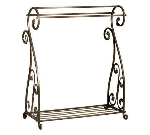 Welcome Home Accents - Metal Quilt Rack - Aged Bronze metal blanket display rack features scrolling and slotted bottom shelf for extra storage space. With three bars for hanging quilts blankets, clothes, etc.  Sturdy enough for the heaviest of quilts.  Assembly required. Dust with a dry cloth.
