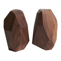 Reed Wilson - Geometric Salt and Pepper Shakers - These salt & pepper shakers are made of walnut. Each set is uniquely shaped by hand. Finished with a water & alcohol resistant, food safe finish. These were designed in collaboration with Lilian Crum from Unsold Studio.