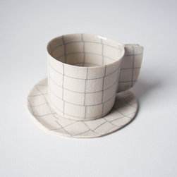 TSC Teacup and Saucer, Check, Cotton by OVO Ceramics - More of a sculptural piece than an everyday object, this cup and saucer with a cotton texture would look great displayed on your open shelving.