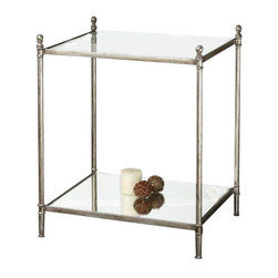 Uttermost Gannon Mirrored Glass End Table - Forged iron frame in antiqued silver leaf with clear, tempered glass top and mirrored gallery shelf. Forged iron frame in antiqued silver leaf with clear, tempered glass top and mirrored gallery shelf.