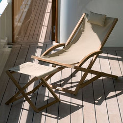 Teak Outdoor Folding Outdoor Chair - It's a wonderful thing to have extra seating when you need it. Even better when it looks great. This is a great lounging chair for a beach or lake house.