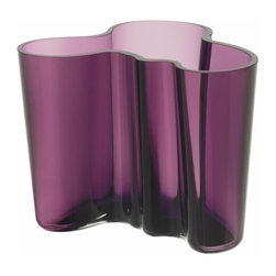 """Iittala - Aalto Vase 4.75"""", Dark Lilac - Forget the florist vase next time you bring flowers to a loved one. The abstract shapes of this glass vessel will take your arrangement to an artful level. Let the stems lean into each wave of glass and rest assured that your gift will be enjoyed for many years to come."""
