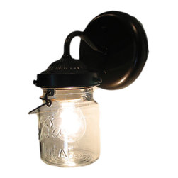 Vintage Mason Jar Sconce Light, Oil Rubbed Bronze - A handcrafted sconce lamp that lights a clear, vintage canning jar with all its own history and 'age' marks. Featuring both the original wire-bails and raised lettering.