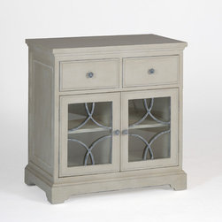 Leigh Chest - Our Leigh Chest is another way that Gabby cleverly incorporates traditional materials in a fresh, exciting way. For this piece, we covered the drawer fronts with fabric and added a metal motif on the glass doors.