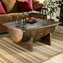 Handmade Vintage Oak Whiskey Barrel Coffee Table - This authentic barrel is a handsome coffee table choice for a wine cellar. I also like that it has storage inside.