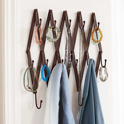 "Viva Terra - Expandable Diamond Coatrack - A jewel of a coat rack, trust us. Its 15 hooks hold not just coats butscarves, necklaces, jewelry, bracelets and hats - all those unrulythings that clutter up dresser tops, drawers and closets. Made ofrecycled metal, it's easy to install and quickly becomes indispensable.EXPANDS TO 65""L x 2.5""D x 13""H"