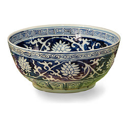 Lily Bowl in Blue and White - Influenced by the fine appointments that grace Grecian estates, the Lily Bowl in Blue & White imparts refined beauty to your transitional appurtenances. The interior rim boasts a traditional Greek key pattern, while the exterior features gentle intertwining scrolls. An organic motif rendered in vivid white offers dramatic contrast to the dark navy blue background that distinguishes the piece.