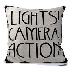 """Concepts Life - Concepts Life Throw Pillow  Typography  Lights, Camera, Action - Any living room becomes a cinematic screening space with these whimsical moving picture pillows. You'll feel like an award winning director lounging on these soft, artful pillows.  Materials: Polyester cover and poly filler Spot clean Dimensions: 18""""h x 18""""w Weight: 1.5 lbs Pillow arrives in a vacuum sealed bag Once the pillow is aired and fluffed it will regain its full, soft and plump shape"""