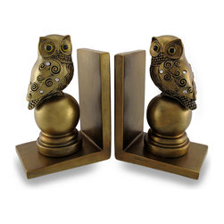 Zeckos - Decorative Antique Gold Finish Mosaic Owl Bookend Set of 2 - This decorative set of perched owl bookends boasts an antique gold finish, an ornate carved mosaic owl accented with clear faceted jewels perching on a round base that resembles a door knob, a scrolling motif, and just the right amount of aging for an elegant accent in your home or office. They would look amazing holding up your prized book collection, or just as beautiful accents on either end of the mantel. Each decorative bookend measures 6.5 inches (17 cm) high, 4.5 inches (11 cm) long, and 3.25 inches (8 cm) wide. The weighted design is sure to hold plenty of novels in place, and they'd make a lovely gift for any book collector or avid reader