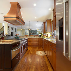 Copper Range Hoods - Blending stainless-steel appliances with a copper range hood creates a modern, warm and inviting feel to any kitchen.