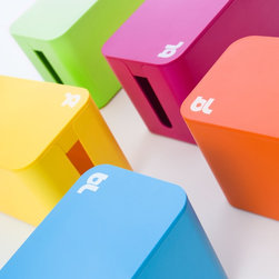 CableBox Mini - Each CableBox Mini comes in a candy color that spells fun. It's a stylish solution for dealing with the cluster of cords by my home office desk.