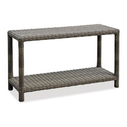 Thos. Baker - Wicker Outdoor Console Table | Hampton Collection - Oversized seating in all-weather wicker with a slightly weathered look inspired by classic whitewashed country home styles. Premium, dyed-through resin wicker with an extra large diameter profile and elegant ocean gray finish. Powder-coated aluminum subframe and brushed aluminum feet.Plush Sunbrella cushion sets included where applicable. Choose quick ship in khaki with cocoa piping, stone green or choose from our made-to-order fabric options.Made-to-order cushion sales are final and ship in 2-3 weeks.