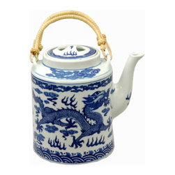 Blue and White Dragon Teapot - This blue and white teapot with a dragon motif and bamboo handles is perfect for the tea lover like me.