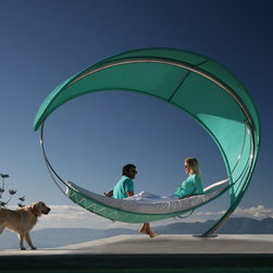 The Wave Hammock - The flow of the Wave Hammock mimics a surfing break, and the seafoam green of the canopy conjures the scent of the ocean — how heavenly! I love that it looks as if the wind may carry it up and away. A clean and minimal space would let the hammock take center stage and maximize its light, airy feel.