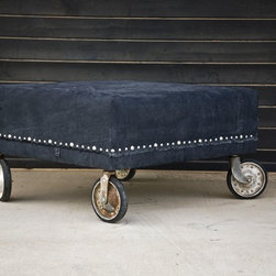 All About Looks - Recycled truck tarp, vintage 1940's wheels, nailhead trim