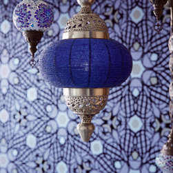 Yasmin - A fresh and exotic décor idea, a midnight blue wallpaper of an eclectic geometric print mixed with colorful mosaic lanterns.