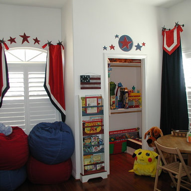 Custom Draperies - Stationary panels hung on decorative iron medallions over the shutters to frame and accent the windows and graphics painted on the walls. Great patriotic look for a child's bedroom.