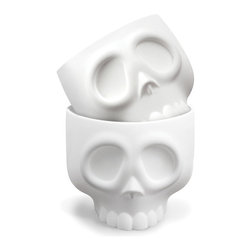 Skull Cupcake Mold - Set of 4 - For the brainy baker, these silicone Skulls Cupcake Molds create perfect cupcake craniums. One bite and you'll be head over heels.